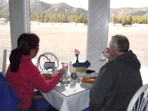 Couple dining with runway view at Barnstorm